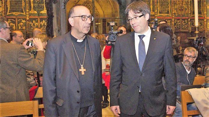 El arzobispo de Barcelona, un moderado que calla, con Puigdemont. EFE