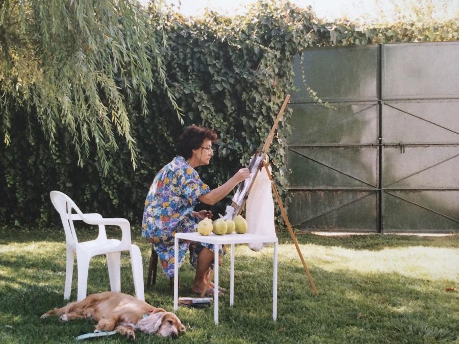Pintando del natural en el campo de la familia.
